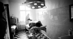 The doctor preparing for surgical attack on the patient. Region's hospital, Pustoshka, Pskov Region, Russia, 2008