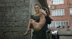 Beslan, North Ossetia, Russia, September 3, 2004. A man carries a wounded girl from a seized school in Beslan, North Ossetia, Russia, Friday, Sept. 3, 2004. Commandos stormed a school Friday in southern Russia where hundreds of hostages had been held for three days. Local officials said 250 hostages were wounded, 180 of them children